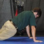 Hip Swivels Push-up Position